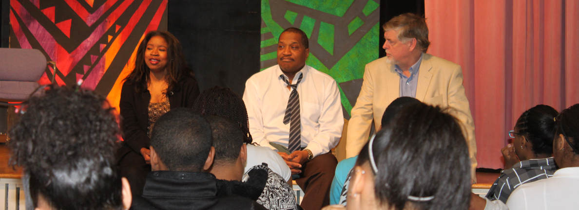 Playwright Chiquita Mullins Lee talks about her play with middle school students after a workshop performance at the Martin Luther King Complex in 2010.  Also pictured: actor Alan Bomar Jones and director Geoffrey Nelson.