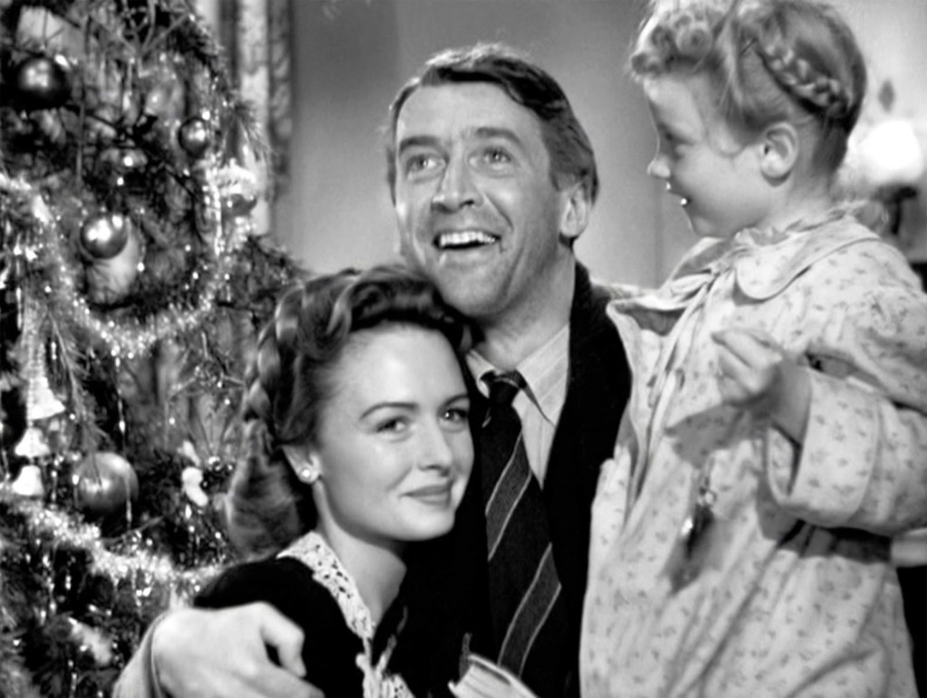 Mary and George Bailey with daughter Zuzu in IT'S A WONDERFUL LIFE